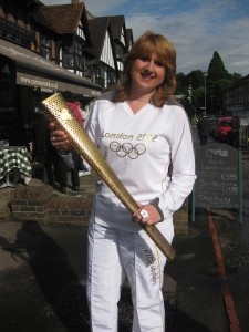 Emma Williams with Olympic torch, Oxted