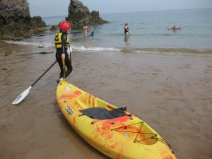 Kayaking at Stackpole on a National Trust family volunteering holiday. Copyright Gretta Schifano