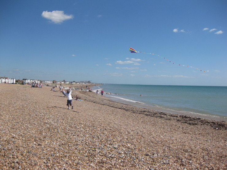 Kite flying on West Worthing beach, UK. Copyright Gretta Schifano