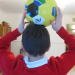 boy with football. copyright gretta schifano