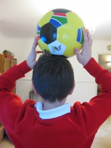 boy with football. copyright gretta schifano