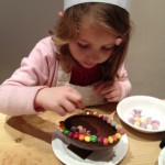 kristina, 5, decorating an easter egg