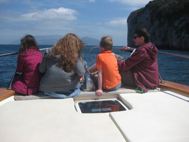 Kids on boat to Capri. Copyright Gretta Schifano.