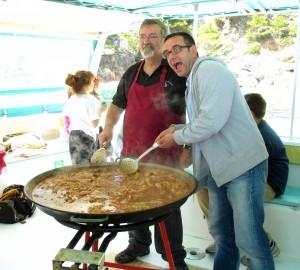 Cooking paella. Copyright Gretta Schifano