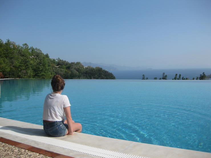 My daughter at Dionysos infinity pool on a trip with Exclusive Escapes. Copyright Gretta Schifano