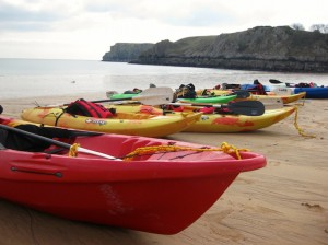 Beach cleaning by kayak, NT Stackpole, Wales. Copyright Gretta Schifano.