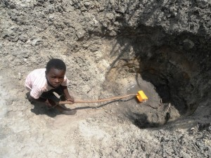 Tanzania: young boy at water source. Image courtesy of Just A Drop