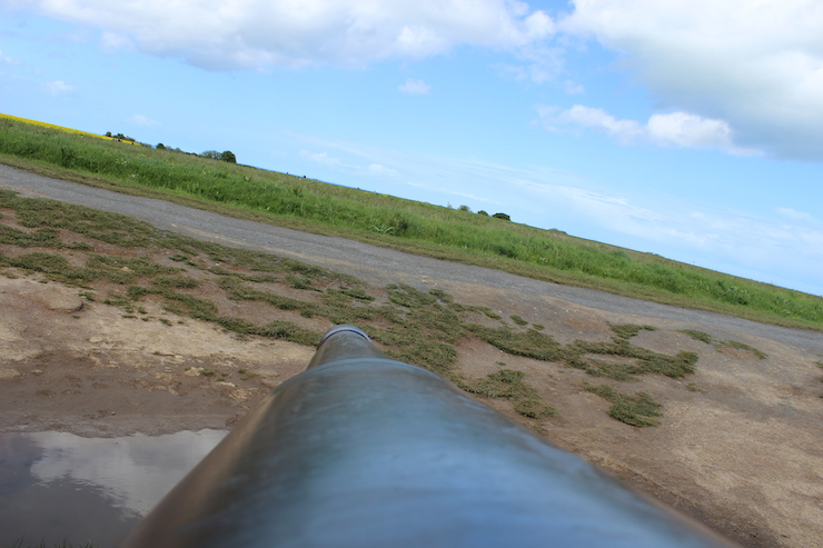 Looking down a gun barrel at Longues-sur-Mer Battery. Copyright Gretta Schifano