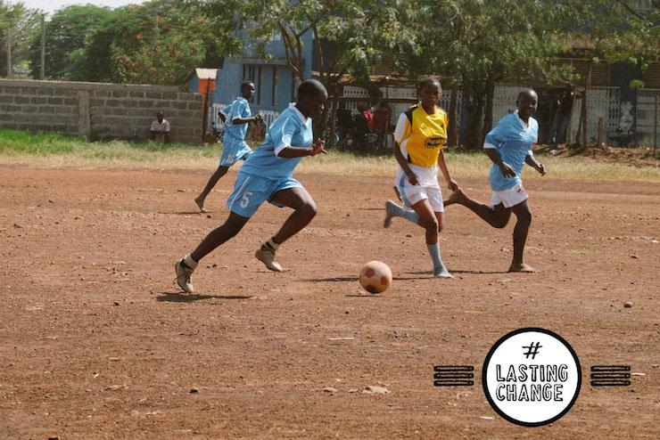 Girls playing football in Kenya. Image by Team Honk