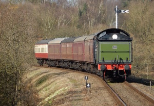 Steam train arriving at Kelling Heath. Copyright Max Rolt Bacino