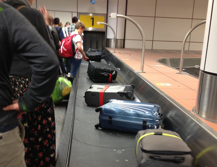 Waiting for luggage to arrive at Gatwick airport. Copyright Gretta Schifano