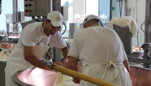 Production at 4 Madonne Caseificio dell'Emilia parmesan factory. Copyright Gretta Schifano