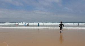 Surfers in Peniche, Portugal. Copyright Gretta Schifano