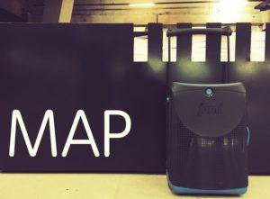 Jurni suitcase next to MAP sign. Copyright Lara Downie