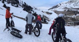 Preparing to cycle down the ski slope. Copyright Gretta Schifano