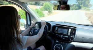 Gretta Schifano driving a Nissan electric car, Menorca. Copyright Steve Biggs, Biggsy Travels