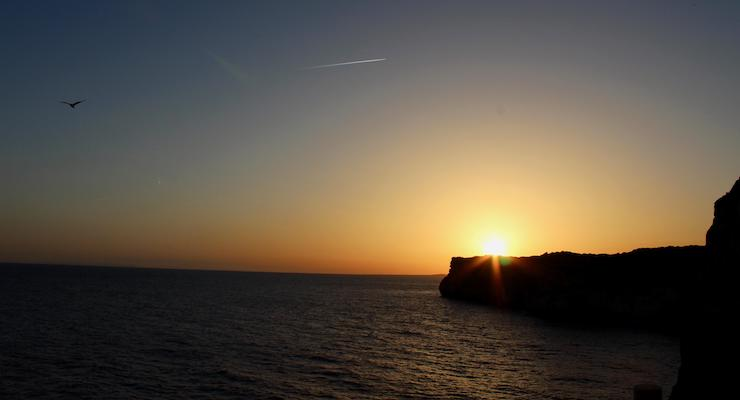 Sunset from Cova d'en Xoroi, Menorca. Copyright Gretta Schifano