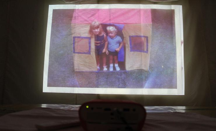 Family slide show with a BenQ GS1 projector. Copyright Gretta Schifano
