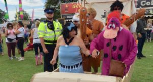 Rewind festival-goers dressed as The Flintstones. Copyright Gretta Schifano