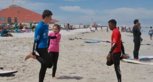 Preparing for a surfing lesson, Muizenberg, South Africa. Copyright Francis Rolt
