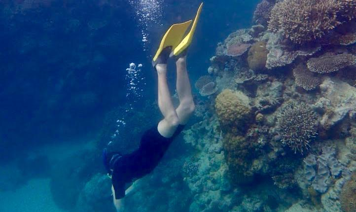 Max snorkelling at the Great Barrier Reef, Australia. Copyright Lorenza Bacino