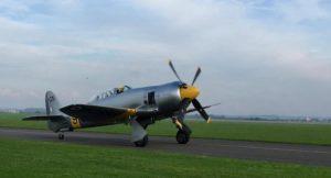 Plane taking off, IWM Duxford, Cambridge. Copyright Gretta Schifano