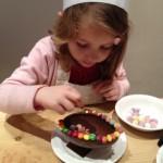 kristina, 5, decorating an easter egg