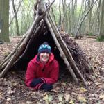 Anne in a Jack Raven bushcraft debris shelter. Copyright Gretta Schifano