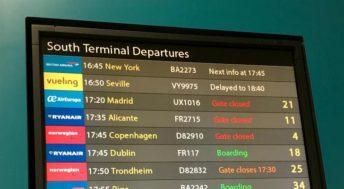 Airport departure board. Copyright Gretta Schifano